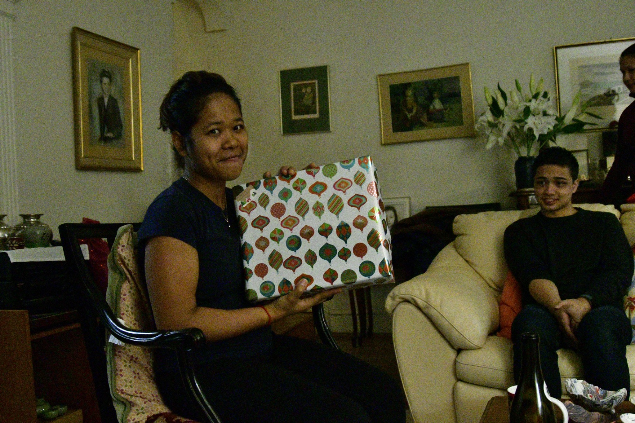 I am looking happy to open my X'mas gift from Nathalie while Phillipe is looking at me in a funny way