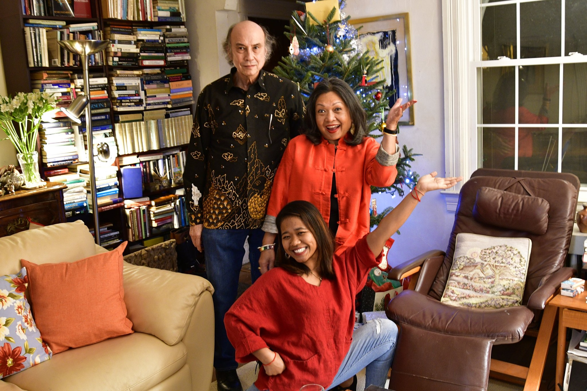 My hosts and I doing a fun pose in front of the Christmas Three